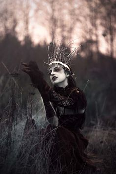 Sarah Bowman is a photographer based in Nanaimo, Canada, whose passion for portraiture and surrealist imagery has blossomed into this darkly beautiful series, entitled Maiden of Ravens.