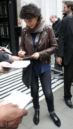 leather jacket + scarf + long shirt + skinnies juliette binoche 2014