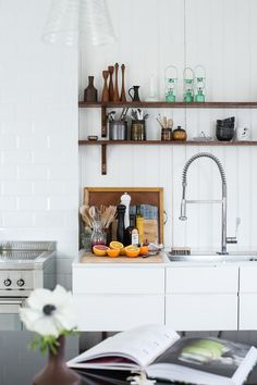 Black, White, and Wood Kitchen Inspiration via Design Sponge