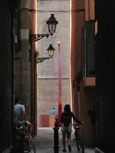 Plaça de les Morere. An eternal flame, placed here in 2001, burns from the top of an elegantly arched torch. Follow this link to see more cool pics of Barcelona!  http://mikestravelguide.com/things-to-do-in-barcelona-stroll-through-the-barri-gotic-and-la-ribera-neighborhoods/