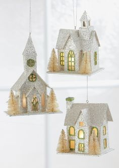 Full of lovely glittery details, these light-up ornament feature tiny golden bristle brush trees to complete the winter-wonderland scene