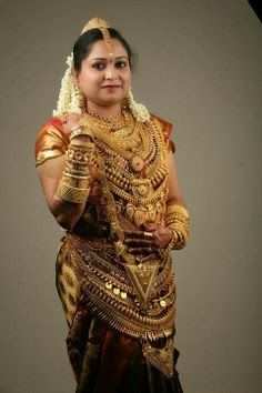 indian bride- must be really strong to bear the weight of all those ornaments! Wedding Jewellery Designs, Indian Wedding Jewelry, Bridal Jewelry, Gold Jewellery, Kerala Jewellery, India Jewelry, Indian Weddings, Indian Bridal Fashion, Indian Bridal Wear