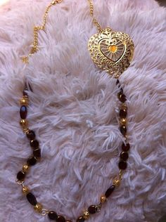 Burgundy beads, gold chain, and large heart charm necklace  on Etsy, $19.99
