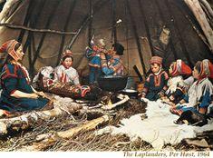 a Saami family inside their lavvu