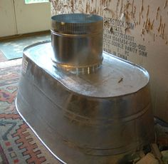Vent hood using large galvanized Washtub. POSM Note: galvanized metal welded off gases poison from the zinc coating. Is it worth the risk with heat? How much heat? Exhaust Hood, Vent Hood, Kitchen Ventilation, Ventilation Hood, Ventilation System, Western Decor, Rustic Decor, Corrugated Metal, Galvanized Metal