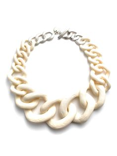 We've called this chic style the Paleo collar for a reason—does it recall anything else but the Stone Age? The links are simply gargantuan not to mention beautifully raw and rustic, and we just love how it melts into cool cold metal at the top.
