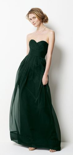 oooh dark green dress - not a fan of strapless or green.......    but i dooo like this :)