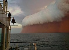 A Red Dust Storm Overtaking Australia's Western Coast 2013 taken by cellphone.