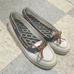 Sperry Top Sider Boat Shoes Cute white and navy sperry top sider shoes! Only selling because they are too small on me (size 7). Lightly worn Sperry Top-Sider Shoes Sneakers