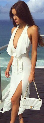 Love her white maxi dress, and she looks like Angelina Jolie omg