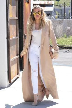 Khloe Kardashian wearing Frame Le High Skinny Ripped Jeans in Blanc, Givenchy Pandora Box Bag in Dark Beige and Gianvito Rossi Suede Pumps