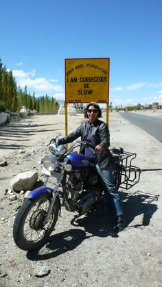 """Ladakh Road Sign - """"I Am Curveceous Be Slow"""""""