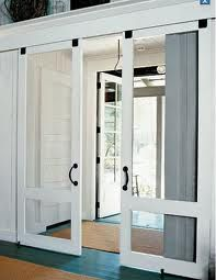 I like idea of having French doors right at the entry, or these type of screen doors between kitchen and outdoor deck or porch.