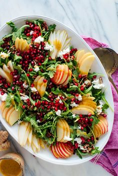 This gorgeous salad is bursting with flavor and fresh fruit! Featuring pomegranate Bartlett pear Honeycrisp apple goat cheese pecans and arugula this salad will brighten up your holiday table. Pomegranate Salad, Pear Salad, Pomegranate Recipes, Apple Salad, Fresh Fruit Salad, Vegetarian Recipes, Cooking Recipes, Healthy Recipes, Cooking Games