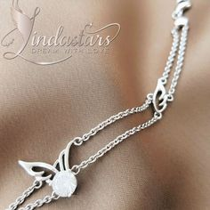Glitter From Within Bracelet makes a stylish embellishment to your fashion jewelry collection. This charming wristband creates a magnificent aura of style and sophistication with its chain design and wing embellishment. The bracelet dazzles like a dewdrop on leaf, it welcomes more success in every prospective of life. Wear it to feel strong and confident from inside.  https://www.lindastars.com/collections/together-for-ever-collection/products/glitter-from-within-bracelet