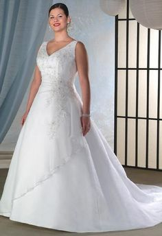 #plussizebrides #plussizegowns #plussizeweddingdresses #dressesforsale | Sleeveless Plus Size Bridal Gown | A-Line Wedding Gown with V neck for a plus size bride | ---- Custom designs and inexpensive replications are available | www.dariuscordell.com/featured/plus-size-wedding-dresses-bridal-gowns/