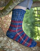 This is the 10th sock in the eBook, and is a very friendly sock to knit. It can be worked with the color changes or all in one color, and also looks very nice in a hand-paint. The texture is very simple lace, easy to follow with the eye. There is ribbing up the back of the leg starting at the ankle, which helps to fit the sock beautifully to most legs.