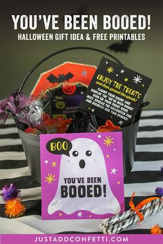 "You've been booed! Spread the spook and surprise your friends and neighbors this Halloween with a fun ""boo bucket"" of treats and goodies! Be sure download the free printable ""You've been booed"" graphics to add to the fun! The free printables are located in the Just Add Confetti printable library. #youvebeenbooed #halloween #boo #boobucket #JustAddConfetti #freeprintables"