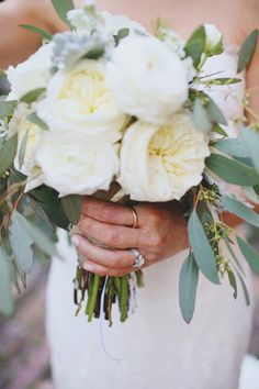 white garden roses paired with pretty foliage. Are those eucalyptus leaves? Whatever they are, we love them Photography by wephotographie.com, Floral Design by buffyhargett.com