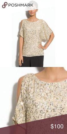 Adrianna Papell Gold Cold Shoulder Sequined Top Worn ONCE, looks brand new. This gorgeous Adrianna Papell top features a champagne gold color in sequins. The style is cold shoulder and the length is enough to tuck into a skirt or pants, or wear similarly to the model. Adrianna Papell Tops Blouses