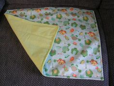Baby Changing Pad with waterproof PUL Material with a flannel backing. Available on my Etsy site PLB Creative Designs.  This is also available in the Monkey,Owl and Flower theme material to match each diaper bag.