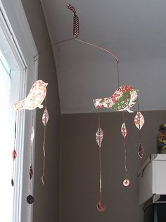 bird mobile from jess in new zealand for the elsie marley mobile swap. i love the origami papers and buttons! it's hanging in my office/art supply room. thank you!     the next massive cash wave of mobile. (learn more on   http://www.localmobilemonopoly.com/?hop=bobmarlei