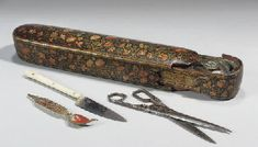 A POLYCHROME LACQUER QALAMDAN AND TOOLS, KASHMIR, 19TH CENTURY ...