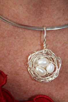 silver wire twisted into a bird's nest pendant