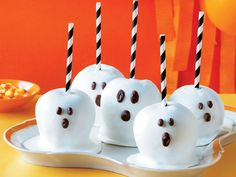 Spooky Candy-Coated Apples | Easy Halloween treats, appetizers, and dessertsare the best way to celebrate this spooky holiday.Create scary-good Halloween treats in minutes by using prepared products--we'll show you how! Start with store-bought cupcakes, bagged candy corn, and even cannedpizza crust to create Halloween treats, Halloween cocktails, and Halloween appetizers that are ideal for your Halloween party. From witch hat cookies to graveyard houses, we've got the quick and easy…