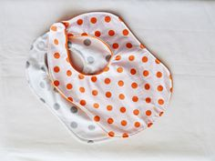 A personal favorite from my Etsy shop https://www.etsy.com/listing/199547223/cute-orange-and-gray-polka-dot-bib-gift