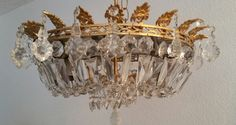 Check out this item in my Etsy shop https://www.etsy.com/listing/293432225/crystal-chandelier-antique-basket-cut