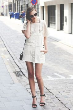 Love those overalls you bought last summer but looking for some new ways to style them this time around? Prepare to get inspired because it's time to pull them out of the closet! As alternatives to skinny jeans, they're the perfect pick for off-duty style this summer and can be worn a ton of different ways (think heels or not, layered with statement pieces or your most basic tee). Let the below girls show you a thing or two about how to style them. Danielle Bernstein of We Wore What paired…