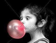 cute kid blowing bubblegum bubble