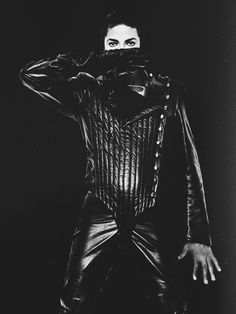 MJ in a black fencing suit.