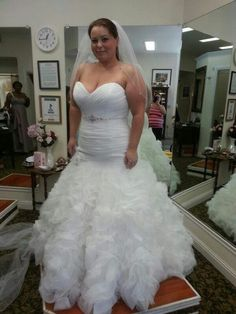 The ruching on this plus size wedding gown is tight and form fitting to the bride.  The flared skirt helps give shape as well. We can provide custom #plussizeweddingdresses like this no mater where you live. Get info on custom designs & replicas of gowns for less at http://www.dariuscordell.com/featured_item/plus-size-wedding-dresses-bridal-gowns/