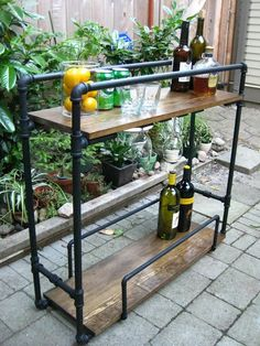 23 Incredible DIY Outside Bar Ideas                                                                                                                                                                                 More Wine Cart, Beverage Cart, Liquor Cart, Pipe Shelving, Closet Shelving, Wood Shelves, Store Shelving, Pipe Bookshelf, Glass Shelves, Strollers, Brewery, Diy, Industrial Furniture, Canoe, Credenzas, Rustic Furniture, Industrial Style Furniture, Industrial Decor, Industrial Bars, Objects