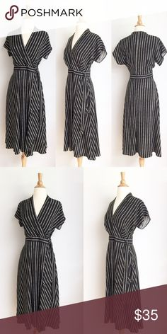 ⭐️Like New⭐️ M&S Collection Pinstriped Wrap Dress Dress has been gently worn but in perfect like new condition. The bust measurement is approximately 17.5 inches across from armpit to armpit and the length is approximately 14.5 inches. The length is approximately 46 inches the fabric content is 100% polyester. This is a UK size 10 which is a US size 6. Marks & Spencer Dresses Midi