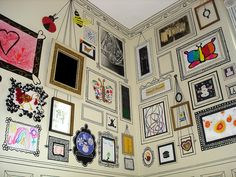 Home Gallery by eklektick who hung her kids' masterpieces and 'framed them' with line drawings using black craft paint. Thanks to honestlywtf. #Gallery #DIY #eklektick #honestlywtf