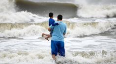 PHOTO: Beach goers watch waves generated by Hurricane Sandy along a breezy Coligny Beach Park on Hilton Head Island, S.C., Saturday morning, Oct. 27, 2012.
