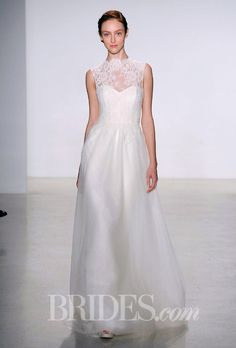 Brides.com: Christos - Fall 2014. Corded lace bodice with high neck and open back A-line wedding dress with full tulle skirt, Christos