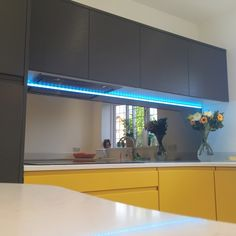 Real handle-less kitchens with mirrored splashbacks.  Colour changing lighting
