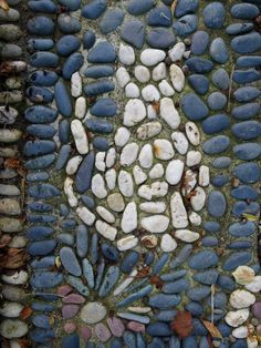 Pebble Mosaic Cat on garden pathway idea