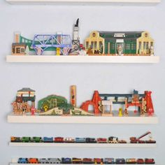 """Keep trains """"on track"""" atop picture ledges, and store larger accessories, like stations, bridges and... - Courtesy of Stacy's Savings"""