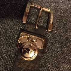 Micheal kors belt size small really good condition Has been worn like maybe three times. Dark brown and tan. With the gold link. Michael Kors Accessories Belts