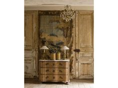 Gorgeous contrast has been created placing the antique Swedish chest between the stripped pine doors.  Love the muted tones on the wall hanging too.