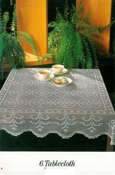 Crocheted gorgeous, classic tablecloth pattern. Photo, diagram and basic lace tutorial instructions.