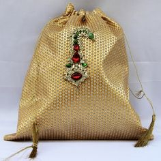 Golden Zari Potli With Kalgi Brooch (Click To Buy | Only Rs 500)