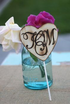 Swashy monogram cake topper. #weddingmonth #typography