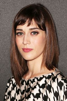 """""""These are very '90s,"""" Santiago continues, """"And right now, what isn't?"""" If you had these bangs in the '90s, raise your hand. If you have them right now, raise your other hand."""