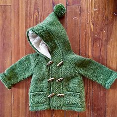 Perfect for an advanced beginner or intermediate knitter, this cozy little coat is knit seamlessly from the top down for the hoodless version and with just one seam at the top of the hood for the hooded version (a seamless hood solution is suggested). Knitted Coat Pattern, Baby Cardigan Knitting Pattern Free, Knitting Patterns Boys, Knitted Baby Cardigan, Knitted Baby Clothes, Coat Patterns, Baby Knits, Knitting Baby Girl, Knitting For Kids
